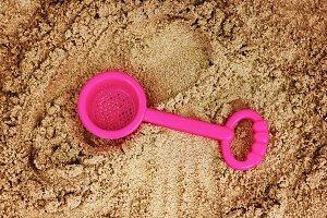 Child`s toy in sandbox
