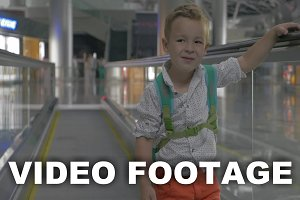 Cute little boy on travelator