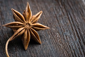 Anise on the wooden background