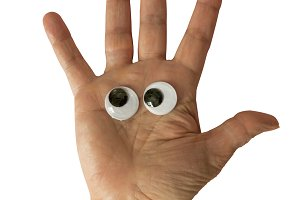 hand with toy eyes