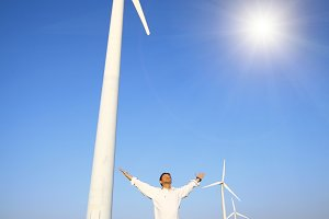 man and wind turbines