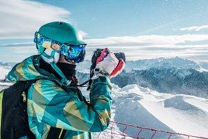 Girl taking pfoto of Mountains
