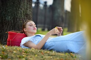 girl lies on a grass in fashionable clothes stockings a sundress