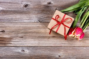 Gift and Flowers on Wood