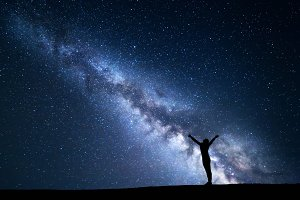 Milky Way with silhouette of a girl