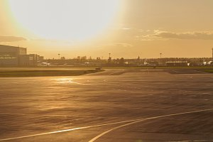 Empty runway at airport. Sunset