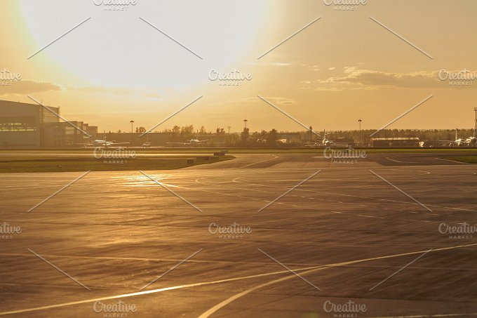 Empty runway at airport. Sunset - Transportation