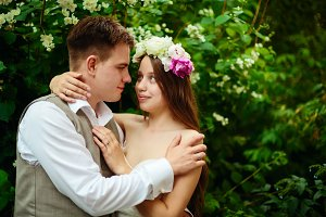Young wedding couple in flowers
