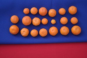 small oranges on blue and red