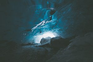 Exploring a blue Glacier Ice Cave