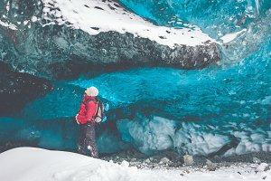 Exploring a blue Glacier Ice Cave