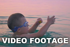 Little boy in goggles turning