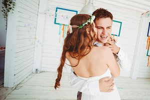 Happy young wedding couple dancing