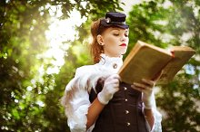 Victorian woman reading book