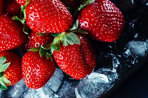 Ripe strawberry on ice