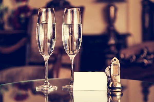Champagne glasses in a hotel room.