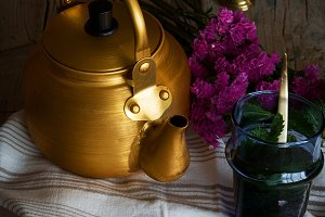 Vintage kettle with glass of tea