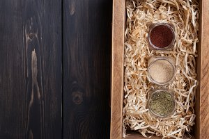 Spice jars in a crate