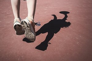 Boy Playing Basketball Shadow
