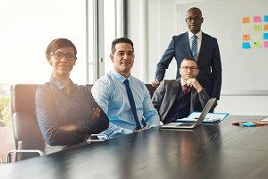 Four confident successful business partners