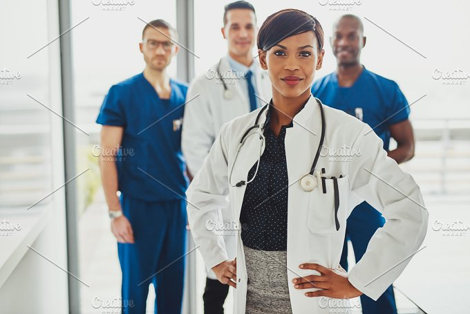 Black female doctor leading medical team - Health
