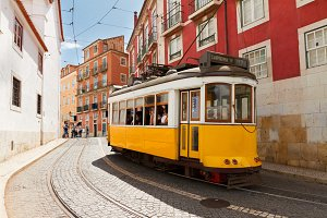 tram on narrow street of Alfama, Lisbon