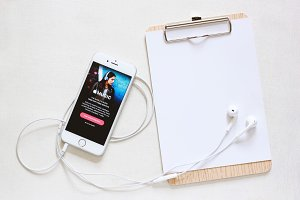 Apple music on smartphone with paper