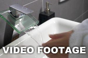 Washing Hands under the Modern Tap