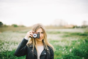 Blonde Girl with vintage camera