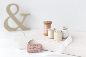 Vintage pink spools styled photo
