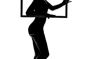 Slim woman holding a frame