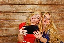 Sisters make fun group selfie. BFF