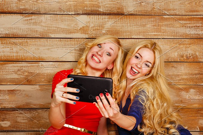 Best friends forever. Sisters selfie - Technology