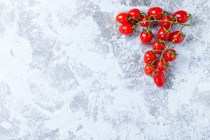 Cherry tomatoes over blue