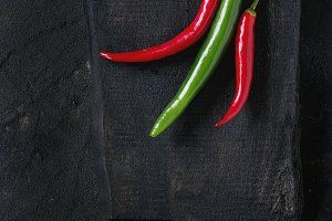 Chili peppers over black