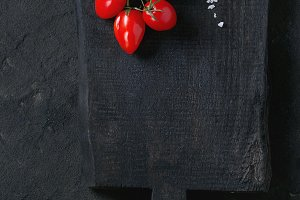 Cherry tomatoes over black