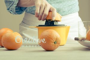 Woman squeezing oranges