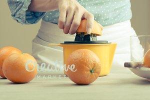 Woman squeezing oranges
