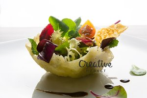 Salad on brie cheese bowl