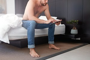 Man in bedroom using touch screen