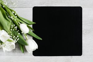 Bouquet of tulips and chalkboard