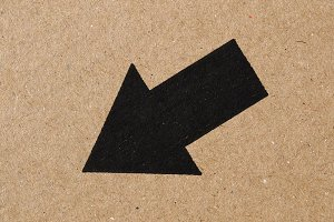 Black arrow on cardboard