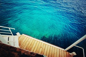 Deep sea and wooden pier