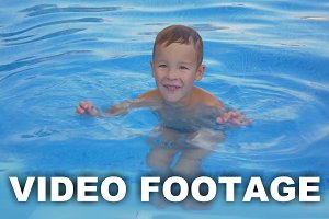Smiling Boy in Swimming Pool