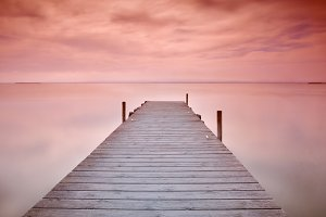 Wooden pier at sunset.
