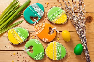 Easter homemade gingerbread cookie and eggs over wooden table