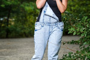 Pin-up girl in denim overalls