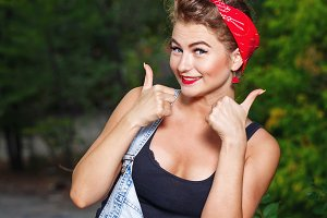 Pin-up girl give thumbs-up