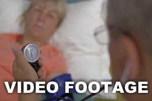 Measuring womans blood pressure