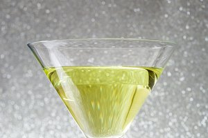 Green apple cocktail on glitter